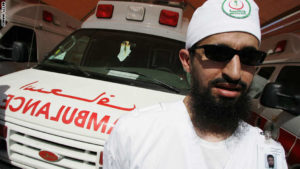A Saudi Red Crescent aid worker stands n