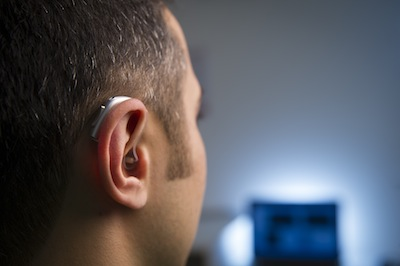 International-experts-to-discuss-ways-of-reducing-hearing-loss-risks-of-living-in-a-noisy-world-pic-man-with-hearing-aid